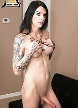 Tattooed tgirl Chelsea Marie shows off her hot well toned body, big tits, a nice ass and a big cock!